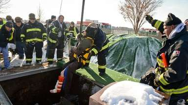 East Farmingdale firefighters rescue a man who fell