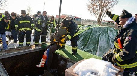 East Farmingdale firefighters rescue a man who fell