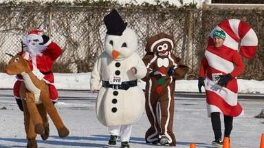 Festively dressed runners participate in the Ho, Ho,
