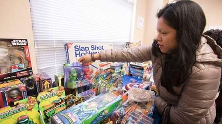 Monica Pacheco of Brentwood picks out toys for