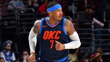 Thunder forward Carmelo Anthony runs up court against