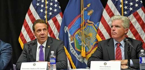 Gov. Andrew Cuomo, left, with Suffolk County Executive