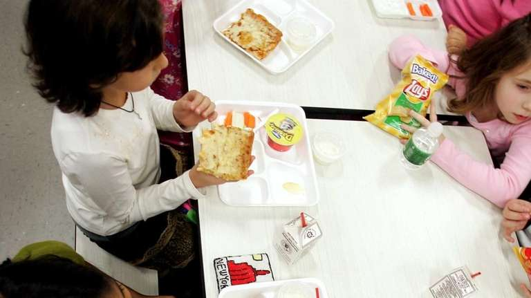 Kids eat during lunch time at Daniel Street