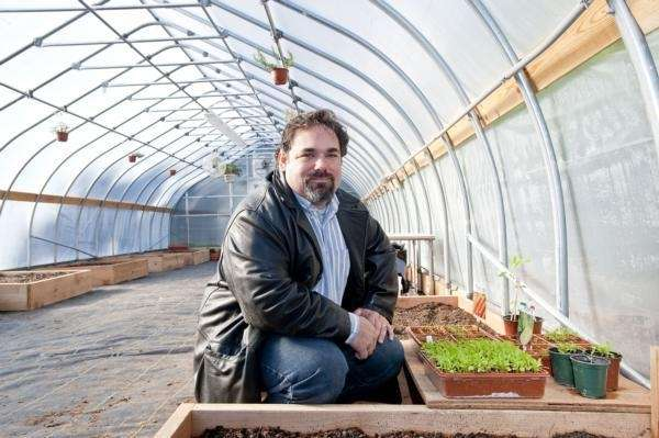 Bryan Futerman inside a new greenhouse at the