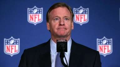 NFL commissioner Roger Goodell listens to a question