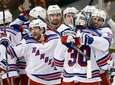 Rangers goalie Henrik Lundqvist celebrates with teammates after