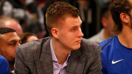 Knicks forward Kristaps Porzingis looks on from the