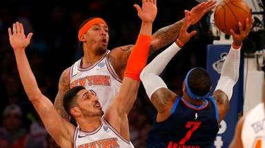 Enes Kanter, front left, and Michael Beasley defend