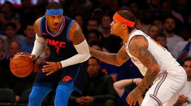 Thunder forward Carmelo Anthony works against Knicks forward