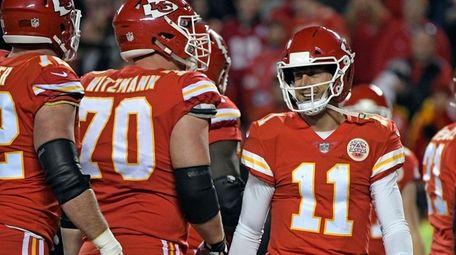 Chiefs quarterback Alex Smith smiles during a game