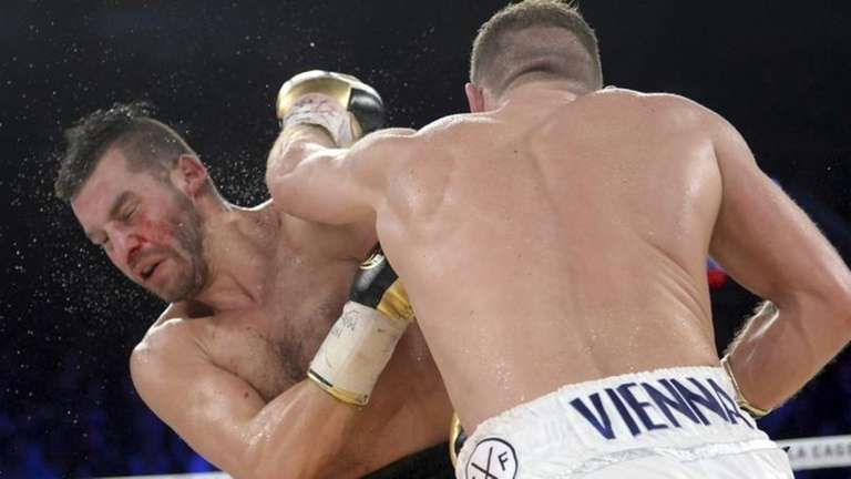 Billy Joe Saunders, right, of Britain, lands a