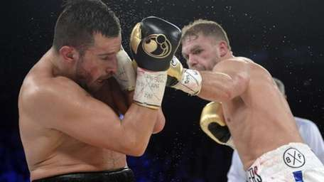 David Lemieux, left, of Canada, defends as Billy