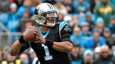Cam Newtonof the Carolina Panthers looks to pass