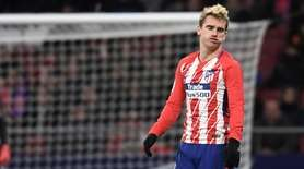Atletico Madrid forward Antoine Griezmann gestures after missing