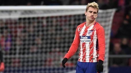 Atletico Madrid forward Antoine Griezmann gestures after missing