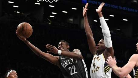 Brooklyn Nets guard Caris LeVert sinks a layup