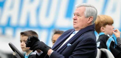 Panthers owner Jerry Richardson watches his team warm
