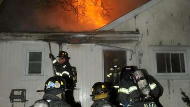 Westbury firefighters battle a house fire on Campo