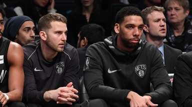 Brooklyn Nets guard Nik Stauskas, left, and center