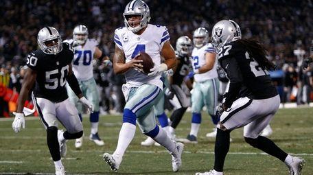 Dak Prescott of the Dallas Cowboys scores on