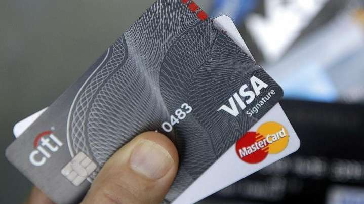 Credit cards are displayed in Haverhill, Mass. on