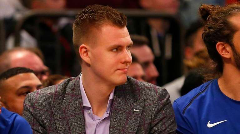 Kristaps Porzingis on the Knicks' bench during a