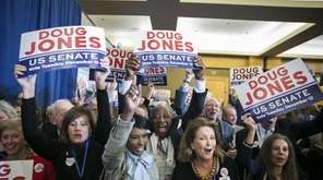 Attendees celebrate during an election night party for