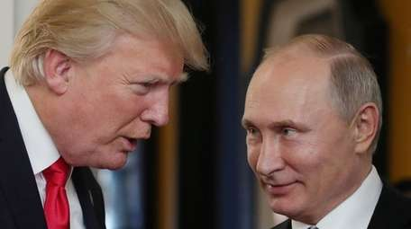President Donald Trump speaks with Russian President Vladimir