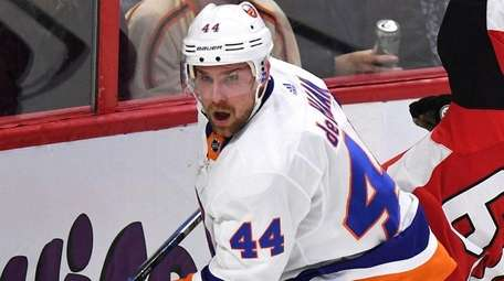 Islanders' Calvin de Haan checks Ottawa Senators' Erik