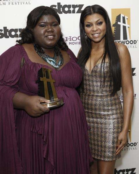 Gabourey Sidibe, left, hold her New Hollywood award