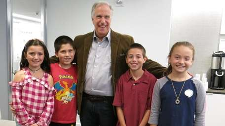 Actor and author Henry Winkler with Kidsday reporters,
