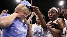 North Carolina coach Sylvia Hatchell is greeted by