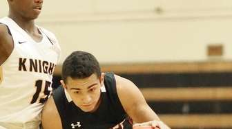 Syosset's Michael Stanco drives up the middle during