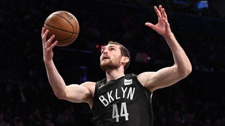 Nets center Tyler Zeller grabs a pass and