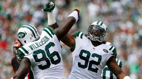 The Jets' Leonard Williams and Muhammad Wilkerson react