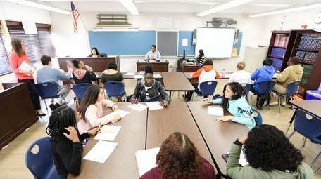 Students participate in a law and government class.