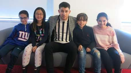 Singer and actor Nick Jonas with Kidsday reporters,