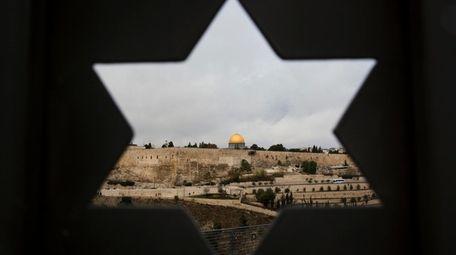 Jerusalem Old City is seen trough a door