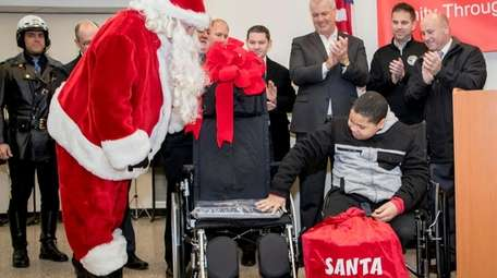 Weslie Capellan receives a new wheelchair and other