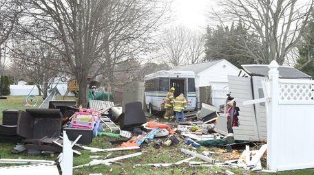 Emergency personnel respond to a Bohemia backyard where