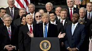 President Donald Trump, center, and Republican congressional members
