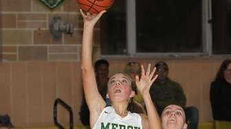 Mercy's Karina Ellis (3) puts one up while