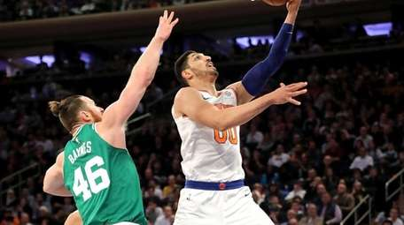 Enes Kanter drives past Celtics' Aron Baynes