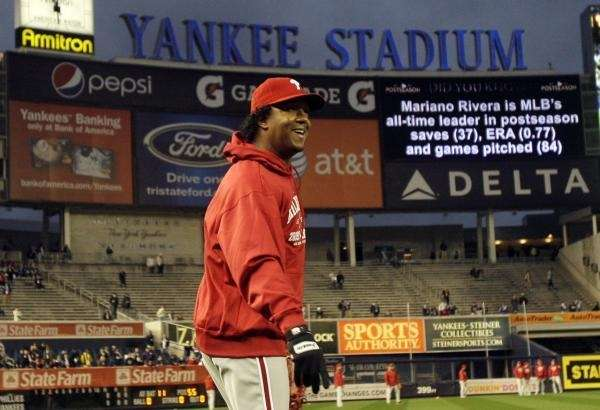 Philadelphia Phillies' Pedro Martinez smiles as he walks