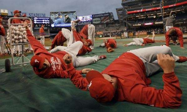 The Philadelphia Phillies warm up before Game 1