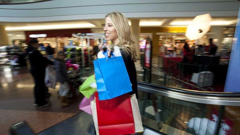 A shopper makes her way through Roosevelt mall