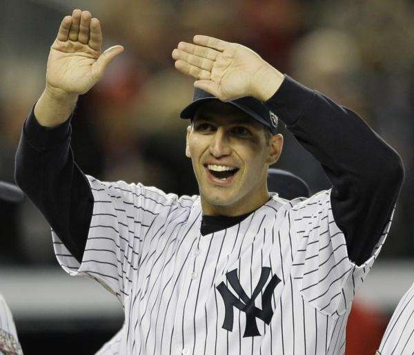 New York Yankees' Andy Pettitte waves to spectators