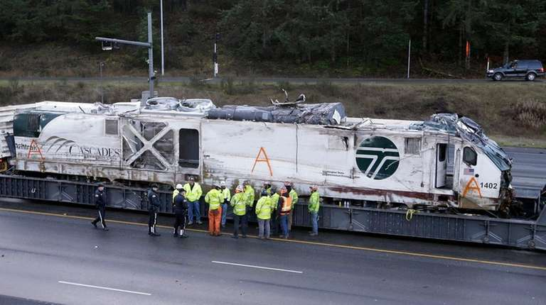 Early NTSB review says crew not using electronic devices before Amtrak crash