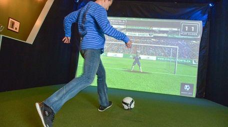 Sanj Hira, of Ronkonkoma, takes a penalty kick
