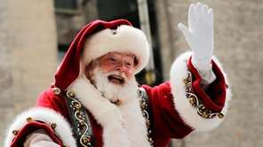 Santa Claus proceeds down Sixth Avenue during the
